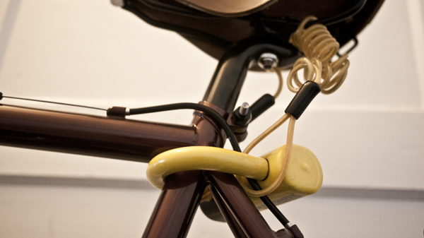 Motorcycle disc brake lock for saddle security.