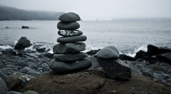 A small cairn built on a beach in Marin.